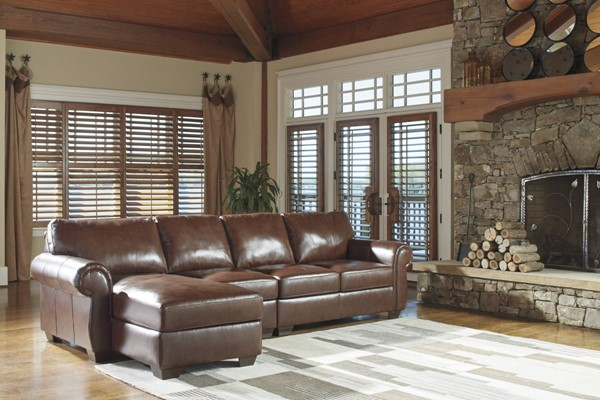 Ashley furniture lugoro saddle laf chaise sectional the for Affordable furniture 3 piece sectional in wyoming saddle