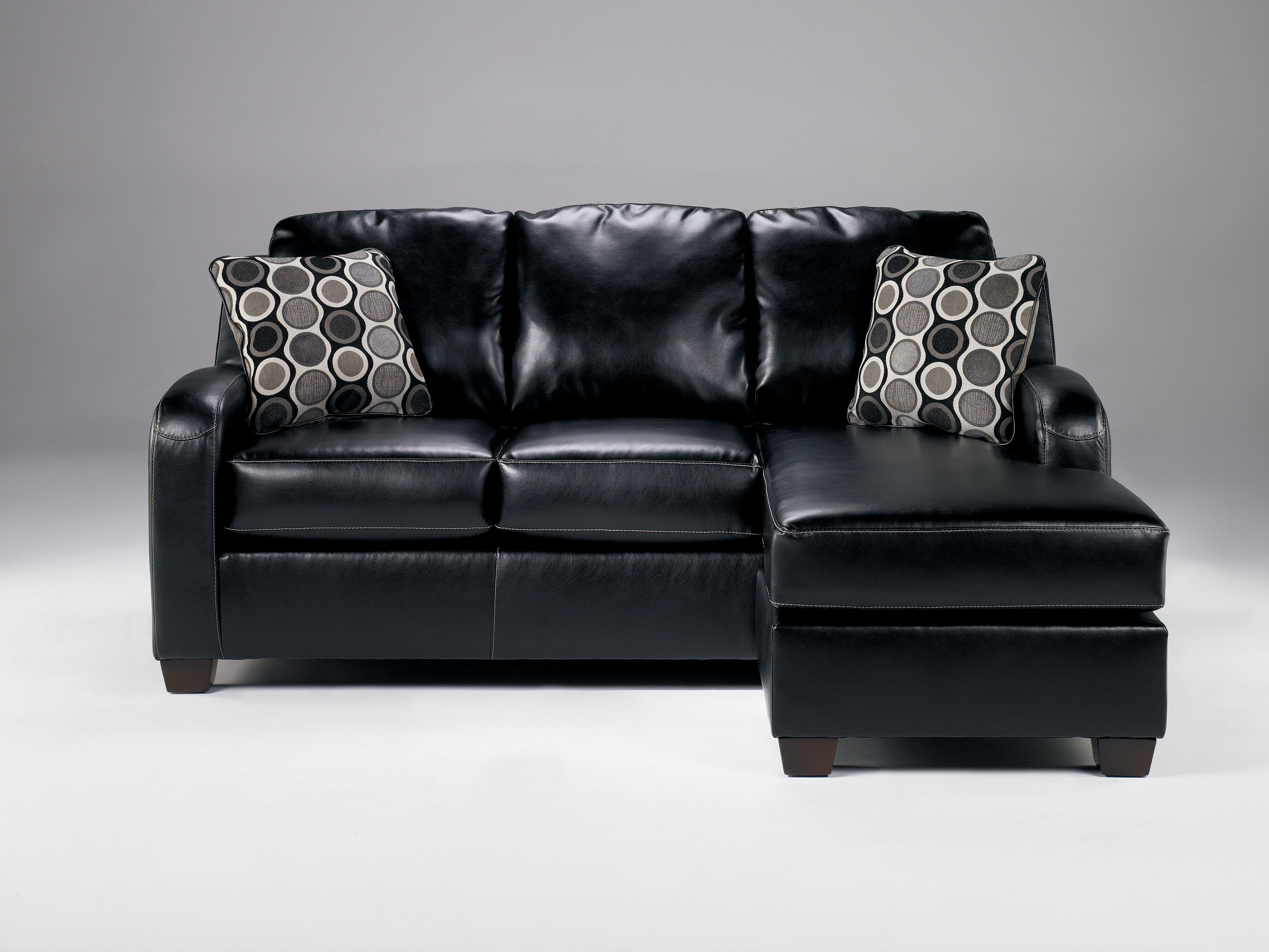Devin durablend black sofa chaise the classy home for Ashley durablend chaise