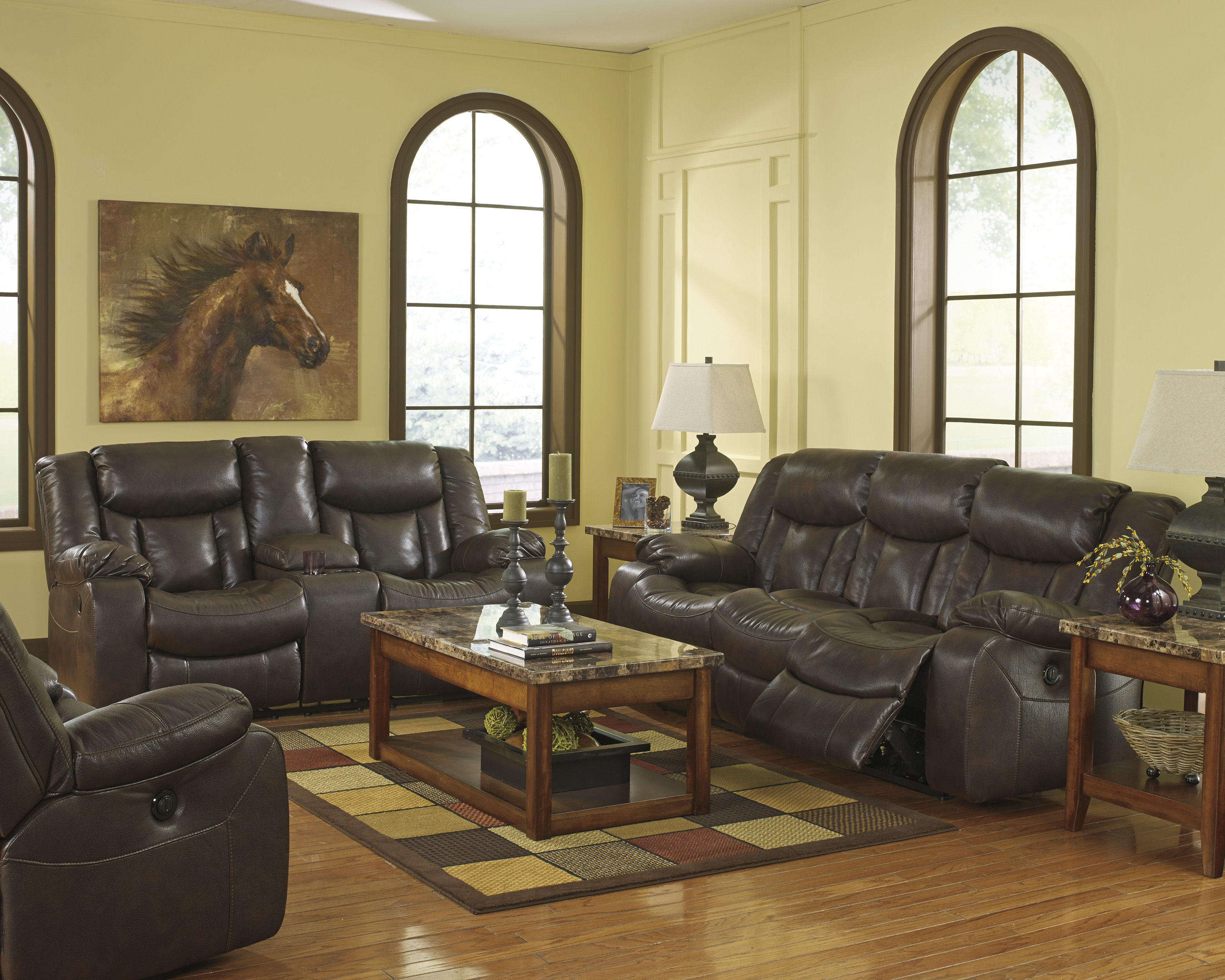 Carnell brown faux leather living room set the classy home for Brown leather living room set